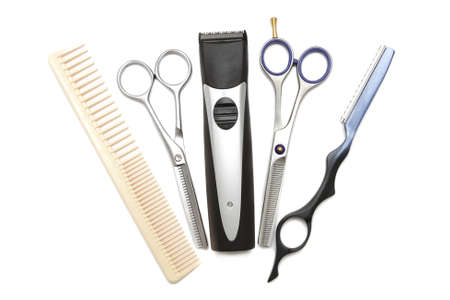 clippers comb: Hairdressing industry. Professional hairdressing tools. Comb, scissor, clippers and hair trimmer isolated on white background Stock Photo