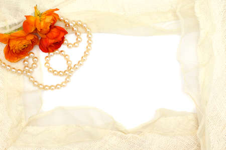 commit: frame from flowers, pearls and tender lace on a white background