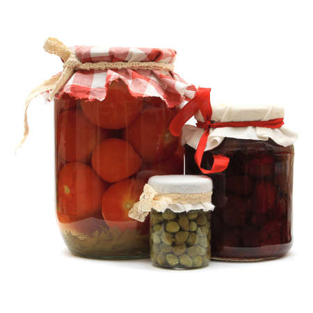 preserves: Jar with preserves. Homemade strawberry jam, pickled tomatoes and capers isolated on white background Stock Photo
