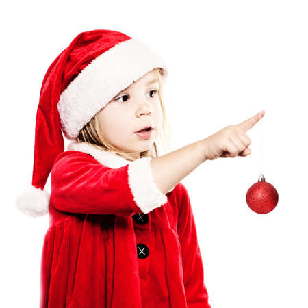 Christmas Child in Santa Hat with New Years Glass Ball Isolated on White Background