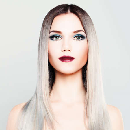 platinum: Stylish Woman Fashion Model with Makeup and Gradient Coloring Hairstyle. Platinum Blonde Silky Hair