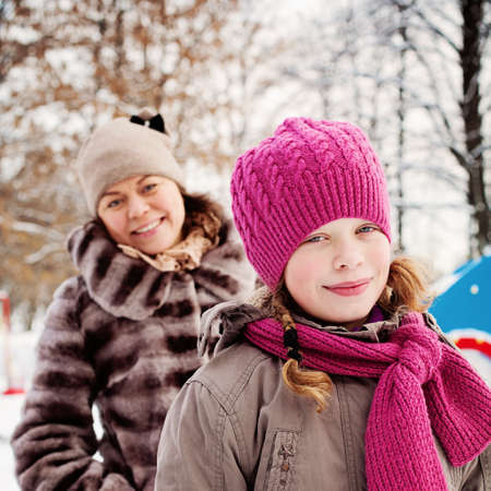 Happy Child Girl in Pink Winter Hat Outdoors