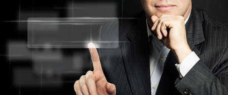 Businessman hand touching empty virtual screen. Can be used for montage your text or pictures at the finger
