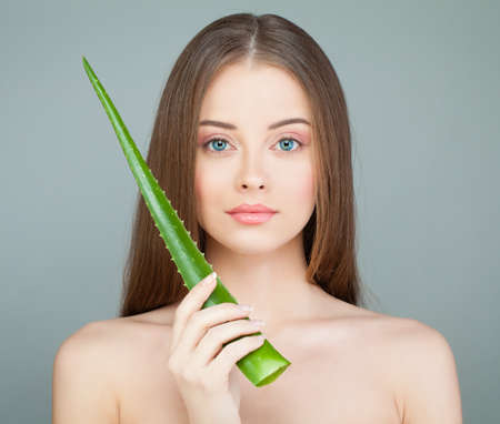 Spa Model Woman with Cute Face, Fresh Skin and Green Aloe Leaf