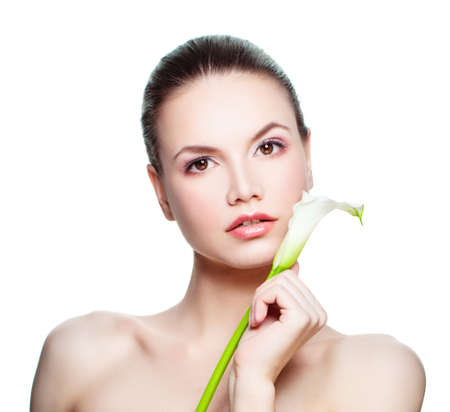 Spa Beauty. Young Woman with White Lyli Flower Isolated on White Stock Photo