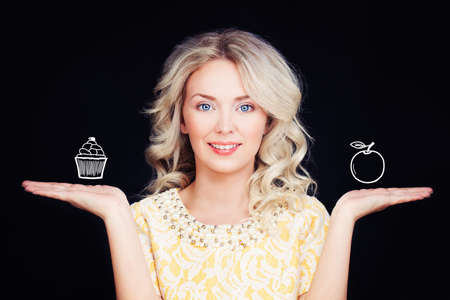 Happy Woman with Health Cake and Apple. Healthy and Unhealthy Food, Choice