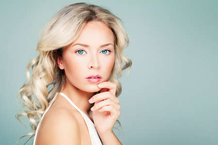 Young Woman Fashion Model with Blonde Curly Hair and Natural Makeup on Blue Banner Background