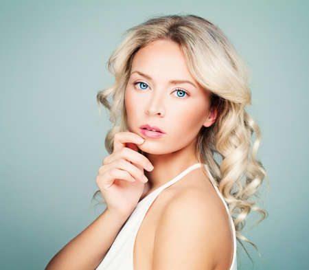 Thinking Model Woman with Healthy Blonde Curly Hairstyle Stock Photo