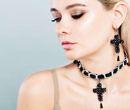 Beautiful Fashion Model Woman with Jewelry Earrings and Necklaces
