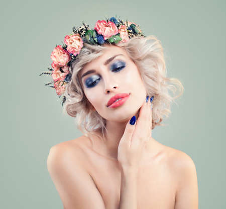 Beautiful Woman in Spring Flowers Wreath on Blonde Curly Bob Haircut
