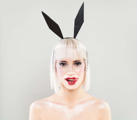 Sexy Woman with Blonde Bob Hairstyle and Red Lips. Sexy Fashion Model with Bunny Ears