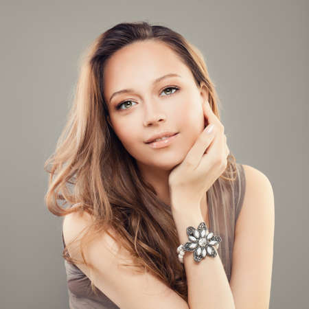 Perfect Woman Fashion Model with Pearls Bracelet on Arm