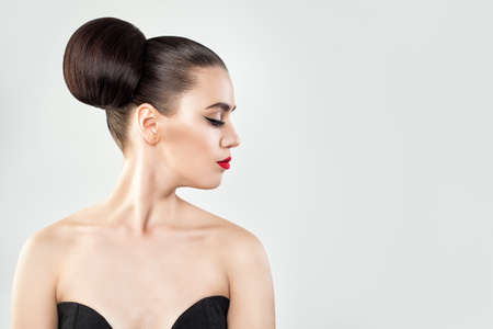 Beautiful Woman with Hair Updo on Background Copy space, Profile Portrait Stock Photo