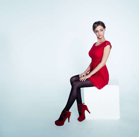 Fashion Woman in Red Dress on White Background
