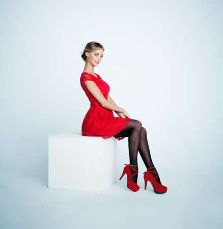Perfect Young Woman in Red Dress on White Background