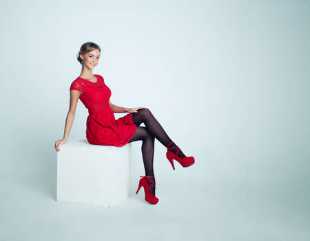 Happy Woman in Red Dress on White Background