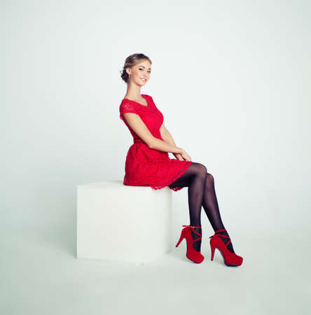 Cute Fashion Model Woman in Red Dress on White Background