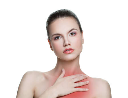 Young woman having a pain in a chest neck area isolated on white background Stock Photo