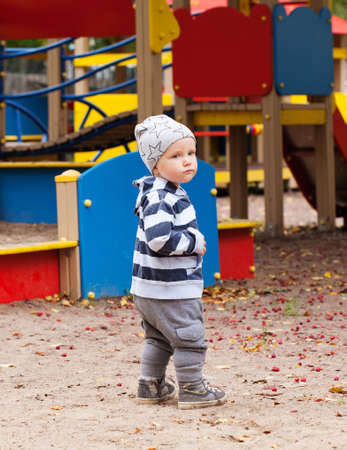 Baby boy playing on playground outdoors