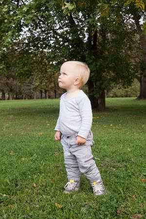 Little baby boy walking in park outdoor Stock fotó