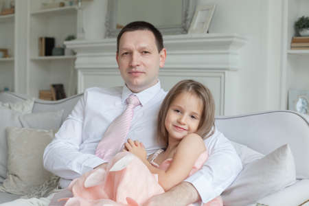 Father and daughter at home, portrait
