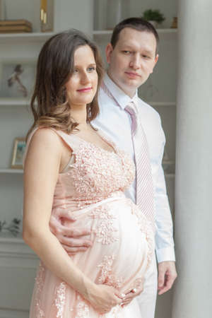 Portrait of lovely future parents at home. Pregnancy, maternity, preparation and expectation concept Stock Photo