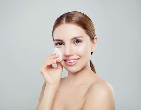Happy perfect woman with clean cotton pads. Skincare concept. Expressive facial expressions Imagens