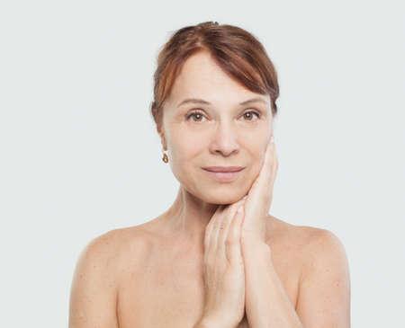Beautiful female face on white