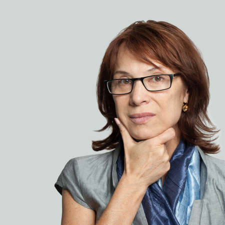 Pensive business woman in glasses thinking, portrait