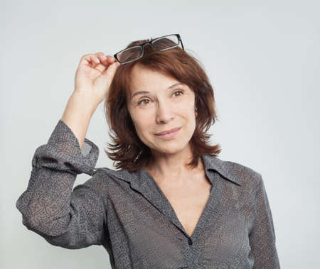 Cute mature business woman with glasses, portrait Stok Fotoğraf