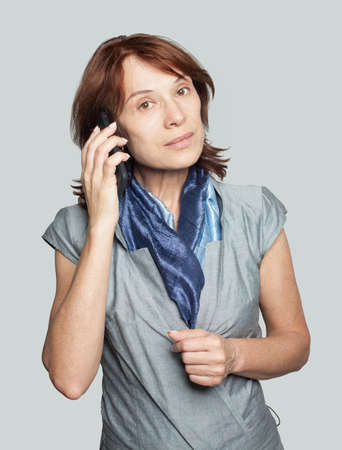 Mature woman phone. Businesswoman cell phone Imagens