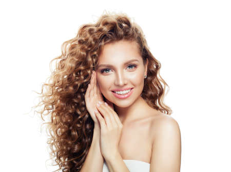 Young woman with healthy skin and blonde curly hair isolated on white.