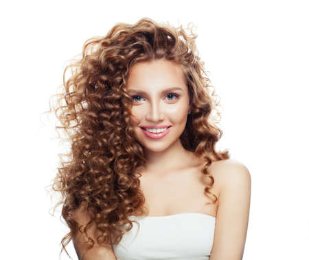 Smiling woman with healthy hair and clear skin isolated on white