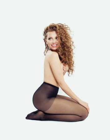 Fashion beauty portrait of beautiful woman in black tights on white Stockfoto