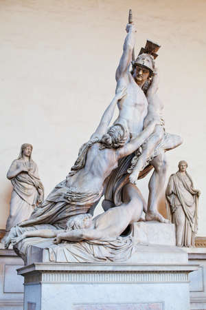 Florence sculpture of The Rape of Polyxena by Pio Fedi sculpture in Loggia Dei Lanzi Piazza Della Signoria Florence, Italy. Firenze landmarks Banco de Imagens