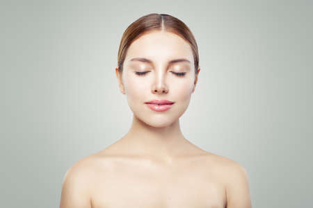 Female model face eyes closed. Young perfect woman with healthy skin. Facial treatment, skincare and cosmetology concept.