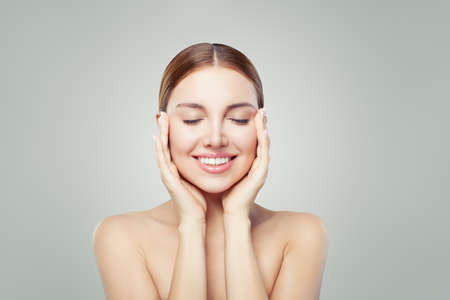 Woman relaxing. Eyes closed. Young perfect female face. Spa treatment, skincare and cosmetology concept. Imagens