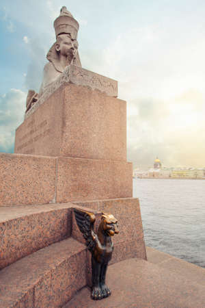 Sphinxes and Griphon in St. Petersburg. Panorama of Petersburg under a blue sky with clouds 免版税图像