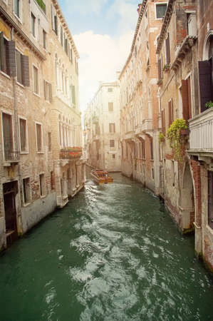 Boat in canal waters of Venice Italy. Water steet in Europe