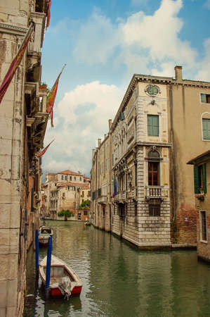 Venetian water canal with boats. Venice Italy