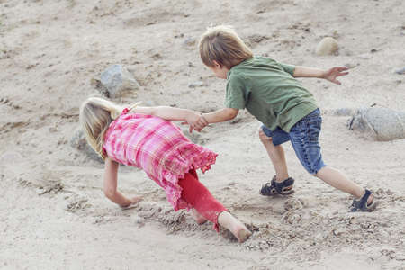 Children help each other. Help concept outdoor