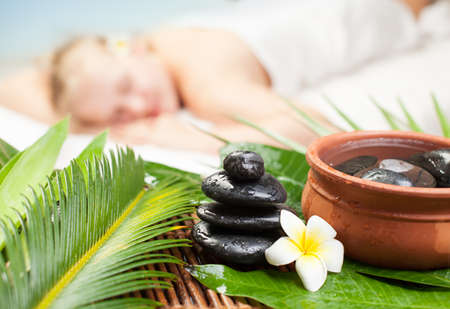 Spa massage on tropical resort.Focus on spa massage objects