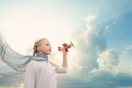 Traveling and freedom concept. Girl in White shirt and airplane Standard-Bild - 122476658