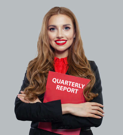 Businesswoman in black suit holding business report on white background
