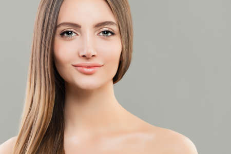 Pretty woman with clear skin and long straight brown hair. Beautiful face closeup Stock Photo