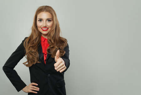 Happy woman in suit with thumb up on white banner background