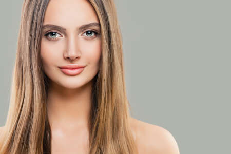 Young perfect woman with clear skin and long straight hair. Natural beauty