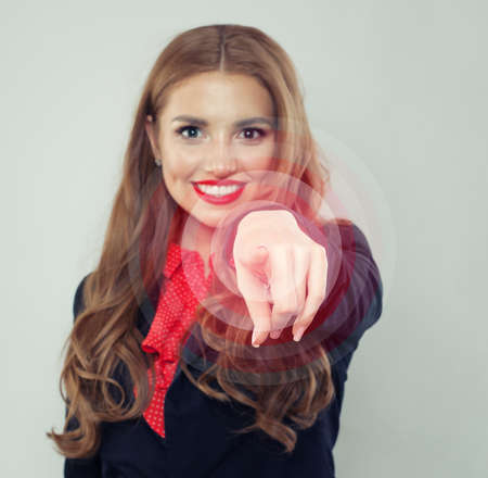 Finger of happy woman pushing a button