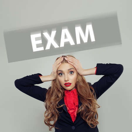 Scared student woman with exam inscription