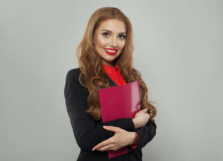 Young woman with red book on white background. Business and education concept